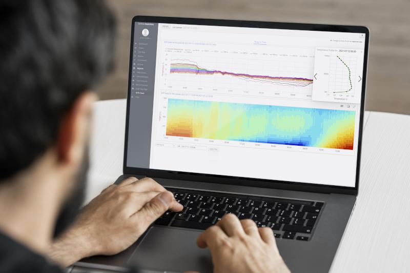 person at computer looking at monitoring data